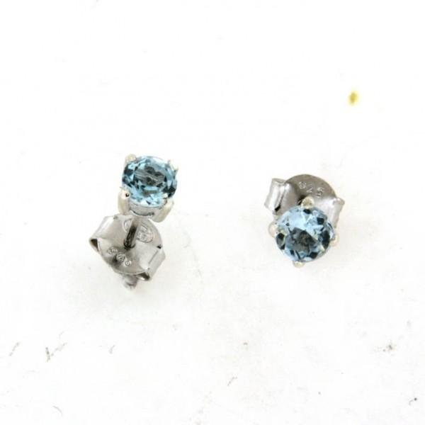 Boucles d oreilles avec topaze bleue